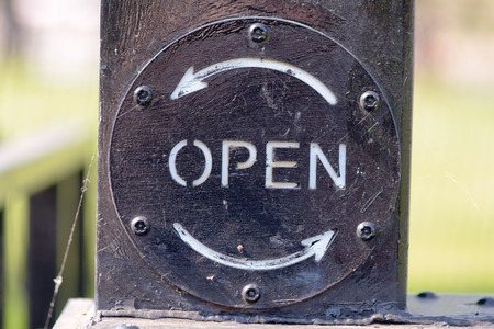 canal lock: Open sign on canal lock gate Stock Photo