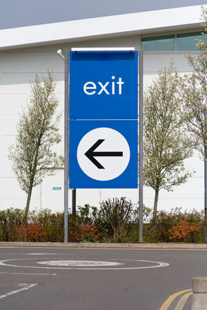 exit sign: Exit sign with direction arrow Stock Photo