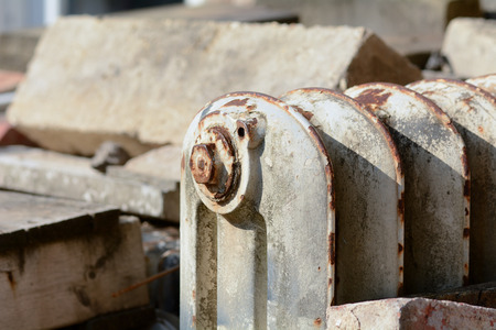 junk yard: Rusty Victorian radiator in junk yard
