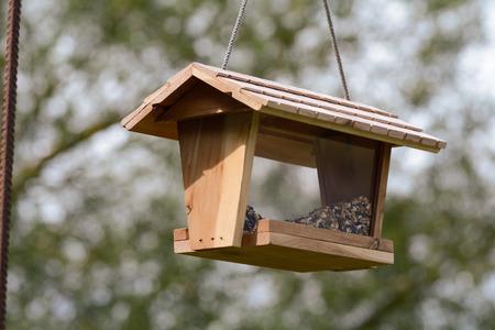 bird feeder: Wooden house hanging bird feeder