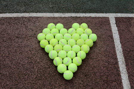 Love heart  in tennis balls Stock Photo