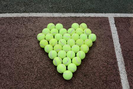 hard love: Love heart  in tennis balls Stock Photo