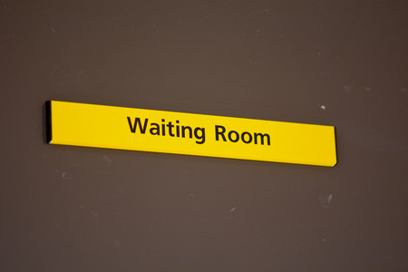 Waiting Room sign on door in hospital Stock Photo