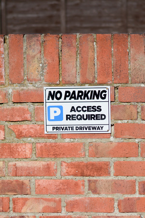 no parking sign: No Parking sign on wall Stock Photo