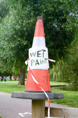 traffic cone: Traffic cone with white paint sign