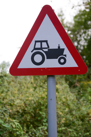 tractor warning: Tractor warning sign Stock Photo