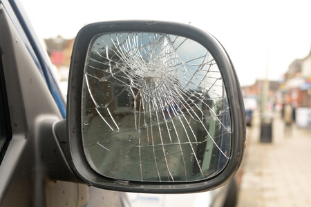 Seven years bad luck  broken car wing mirror Stock Photo