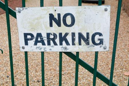 no parking: No parking sign on gate