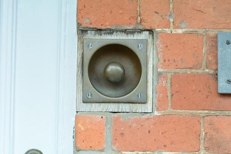 man made object: Brass doorbell Stock Photo