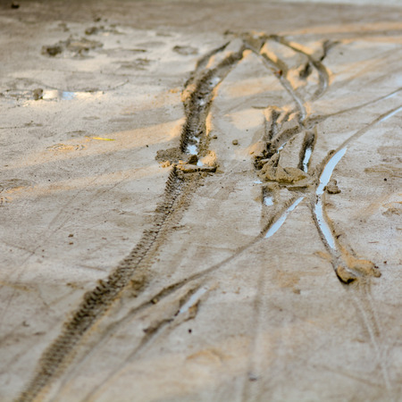 indentation: Tyre tracks in wet concrete Stock Photo