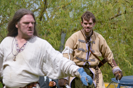 recreate: Willington Bedfordshire England  4 May 2015  Viking reenactment group sword fighting display Editorial