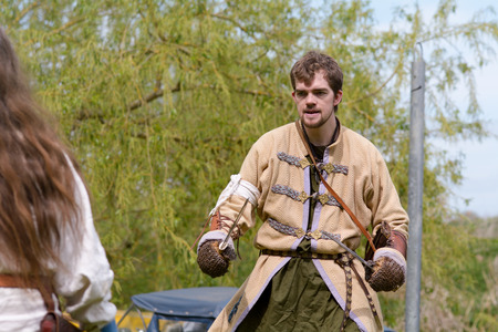 recreate: Willington Bedfordshire England  4 May 2015 Viking reenactment group sword fighting display