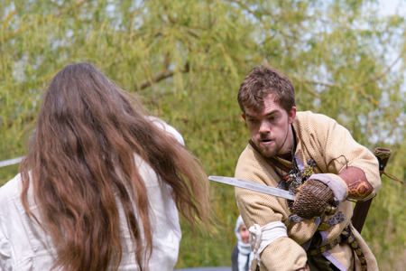 watch groups: Willington Bedfordshire England  4 May 2015  Viking reenactment group sword fighting display Editorial