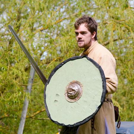 sword fighting: Willington Bedfordshire England  4 May 2015  Viking reenactment group sword fighting display Editorial