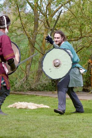 scandinavian people: Willington Bedfordshire England  4 May 2015  Viking reenactment group sword fighting display Editorial
