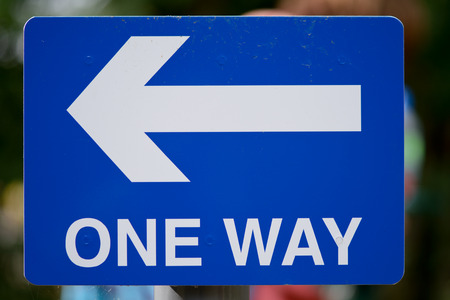 one way sign: One Way sign with direction arrow Stock Photo