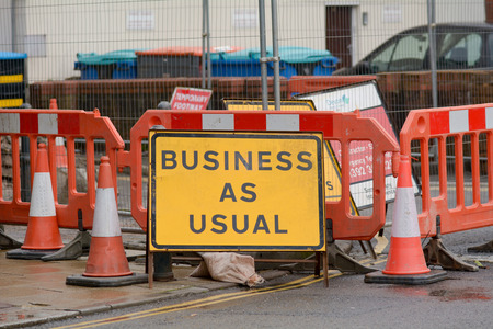 Business as usual sign  during construction works Stock Photo