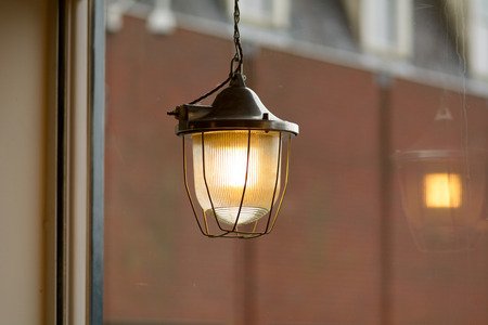 fitting in: Light fitting in cafe window