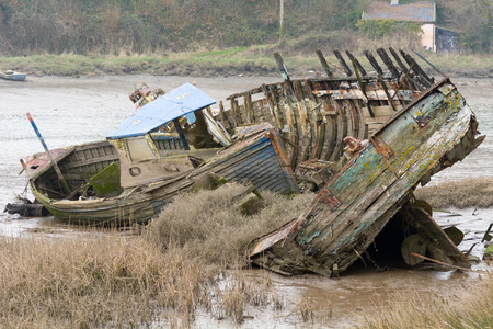 holed: Two boats entwined and left to rot on side of river