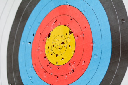 active arrow: Archery target full of holes Stock Photo