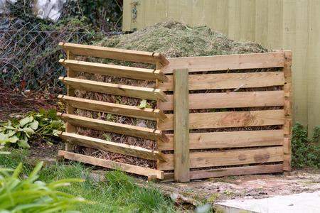 man made object: Compost bin in garden Stock Photo
