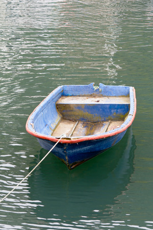 Small blue boat in Polperro harbour Cornwall England