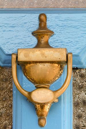 man made object: Brass door knocker
