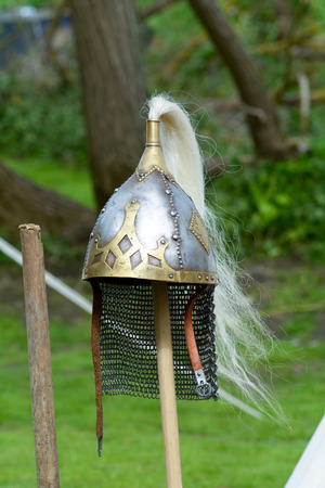 deflect: Viking helmet on wooden pole