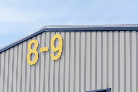 prefab: Factory Units 8 and 9 sign Stock Photo