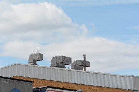 vents: Chimney vents on factory roof Stock Photo