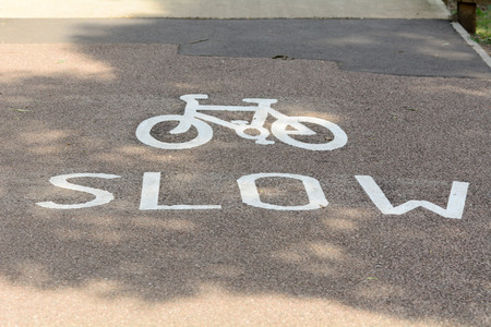 slow lane: Bicycle slow sign and symbol in cycling lane