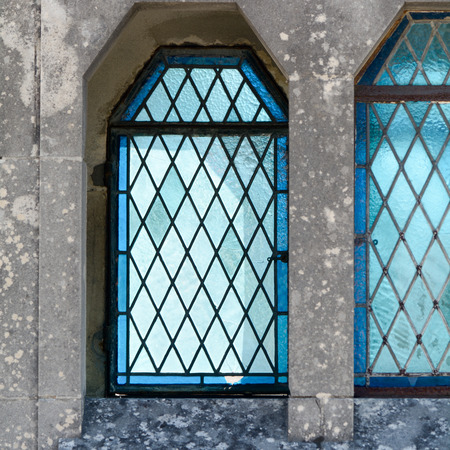 stained glass windows: Blue stained glass windows in tomb Stock Photo