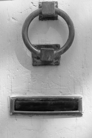 letterbox: Iron door knocker and letterbox