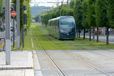 disembark: Tram leaving Stalingrad stop on line B in Bordeaux France