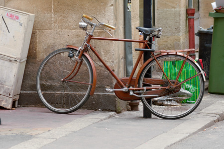 locked in: Bordeaux France June 23 2015: Bicycle chained to lamppost in the centre of the city