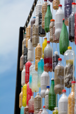 tourney: Bordeaux France June 23, 2015: Art Display plastic bottles filled with colorful stones hanging from string in frame on show at Allee de Tourney in the city centre