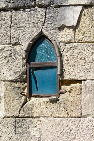 bordeau: Broken blue stained glass window in cemetery tomb in Bordeaux France