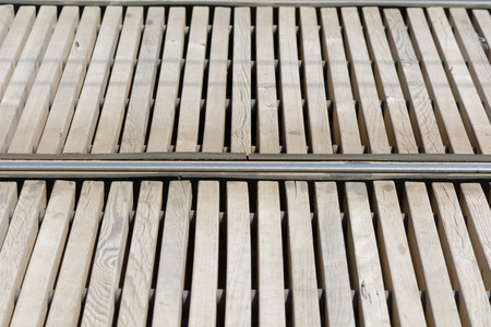 tran: Tram rails and wooden slats at tram stop in Bordeaux, France