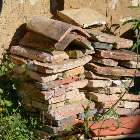 roof tiles: Stack of terracotta roof tiles