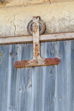 sliding door: Sliding door wheel on barn Stock Photo