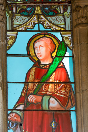 stained glass panel: Bordeaux, France June 24, 2015: Stained glass window of male Saint in tomb in cemetery