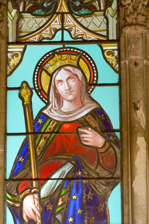 stained glass panel: Bordeaux, France June 24, 2015: Stained glass window of female Saint in tomb in cemetery Editorial