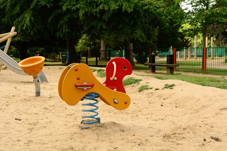 back and forth: Childs playground spring toy Stock Photo