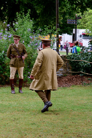 reenact: Bedford, England July 19, 2014: World War One re-enactment Cavalry Officer and soldier at Bedford River Festival