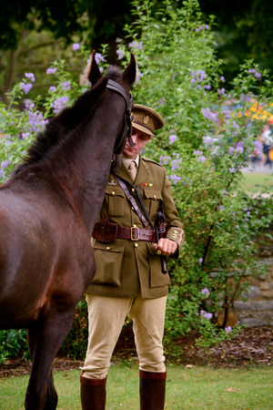 cavalryman: Bedford, England July 19, 2014: World War One re-enactment Cavalry Officer with Horse at Bedford River Festival