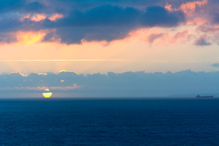 english channel: Sunset over English Channel with boat on horizon