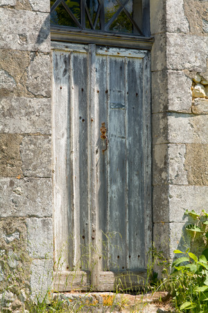 battered: Old battered wooden door to French property