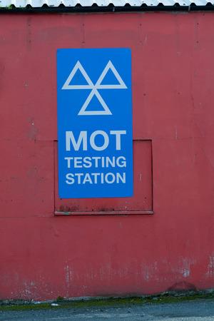 mot: MOT Testing Station sign on garage wall