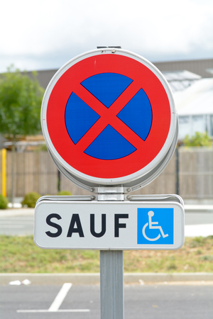 drivers: No Parking - disabled drivers only - sign in France Stock Photo