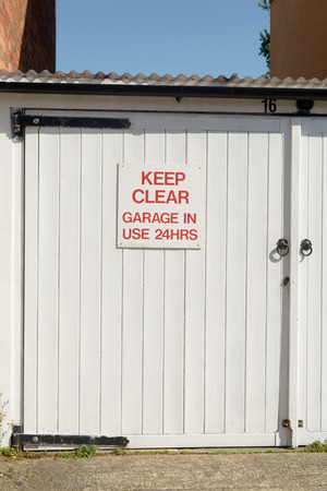 24 hours: Keep Clear Garage in use 24 Hours sign